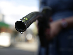 Embargoed to 0001 Saturday June 3 File photo dated 03/08/14 of a car being filled up at a petrol station. Holidaymakers motoring around Europe this summer are facing steep price hikes, but some destinations will still offer fuel for less than £1 per litre, research has found.