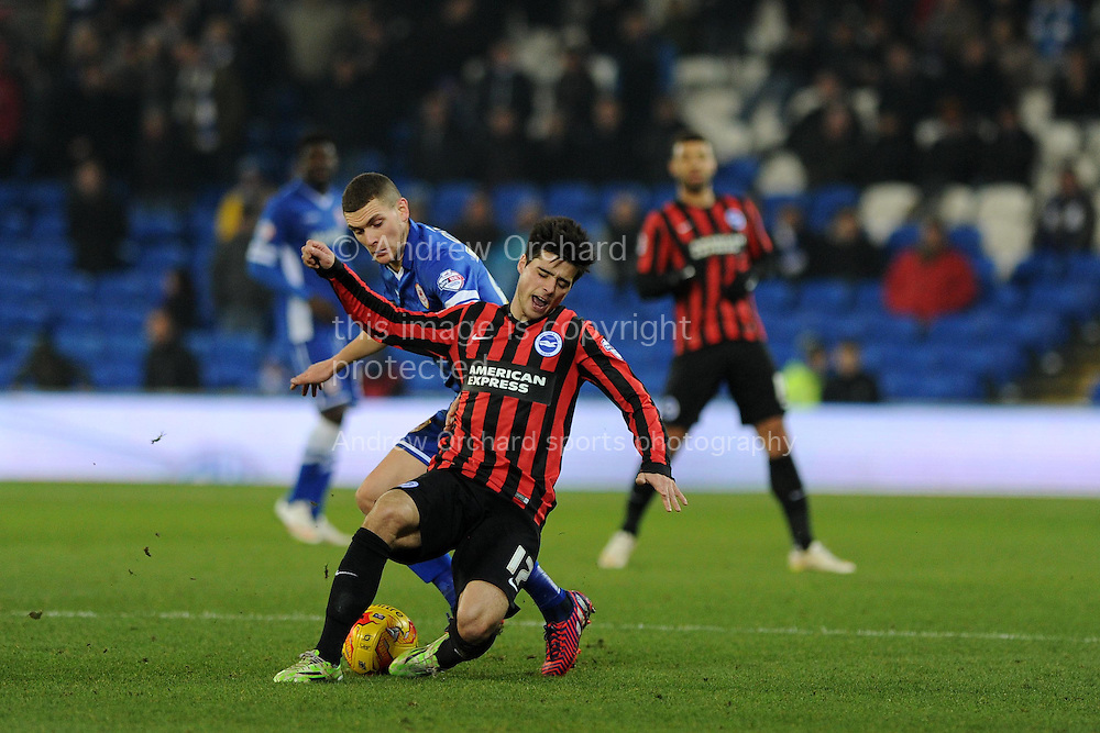 Brighton's Joao Teixeira is tackled by Cardiff's Stuart O'Keefe. Skybet football league championship match, Cardiff city v Brighton & Hove Albion at the Cardiff city Stadium in Cardiff, South Wales on Tuesday 10th Feb 2015.<br /> pic by Andrew Orchard, Andrew Orchard sports photography.