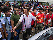23 JUNE 2016 - MAHACHAI, SAMUT SAKHON, THAILAND:  Burmese migrant workers block a road in Samut Sakhon while they wait for Aung San Suu Kyi  to arrive. They were upset because they couldn't get in to the venue to Suu Kyi. They stopped several busses of invited guests from using the main road in to the venue. Tens of thousands of Burmese migrant workers, most employed in the Thai fishing industry, live in Samut Sakhon. Aung San Suu Kyi, the Foreign Minister and State Counsellor for the government of Myanmar (a role similar to that of Prime Minister or a head of government), is on a state visit to Thailand. Even though she and her party won the 2015 elections by a landslide, she is constitutionally prohibited from becoming the President due to a clause in the constitution as her late husband and children are foreign citizens       PHOTO BY JACK KURTZ