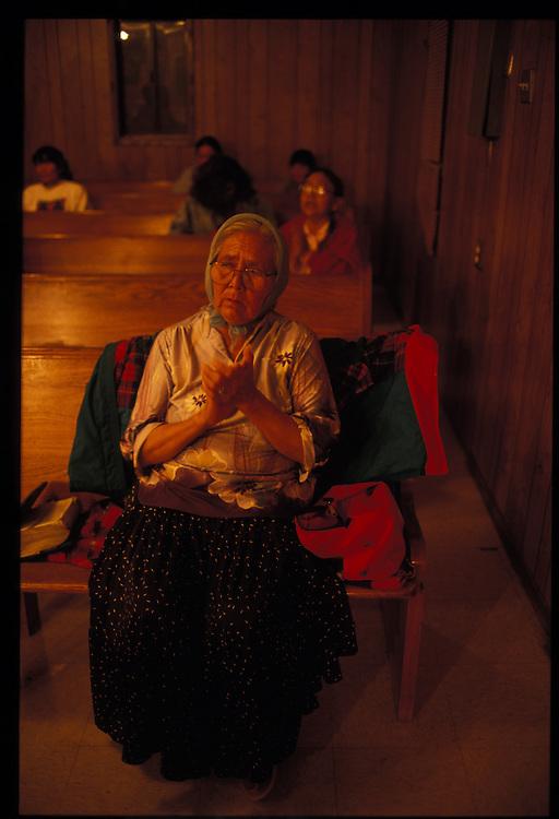 A believer listens to repentant sinners at Eugene Chee Sr., Methodist revival.  Oljato, Utah.