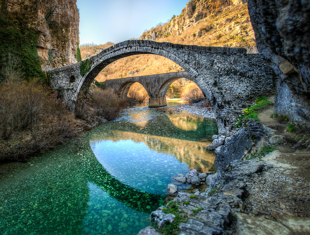 Kokkoris Bridges in Greece. Two bridges with reflections in the water