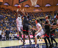 Dec 14, 2019; Morgantown, WV, USA; West Virginia Mountaineers forward Oscar Tshiebwe (34) shoots over Nicholls State Colonels forward Ryghe Lyons (35) during the second half at WVU Coliseum. Mandatory Credit: Ben Queen-USA TODAY Sports