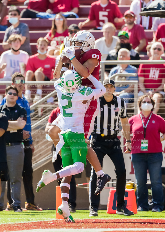 PALO ALTO, CA - OCTOBER 2:  Brycen Tremayne #81 of the Stanford Cardinal catches a touchdown pass while defended by Mykael Wright #2 of the Oregon Ducks during an NCAA Pac-12 college football game on October 2, 2021 at Stanford Stadium in Palo Alto, California.  (Photo by David Madison/Getty Images)