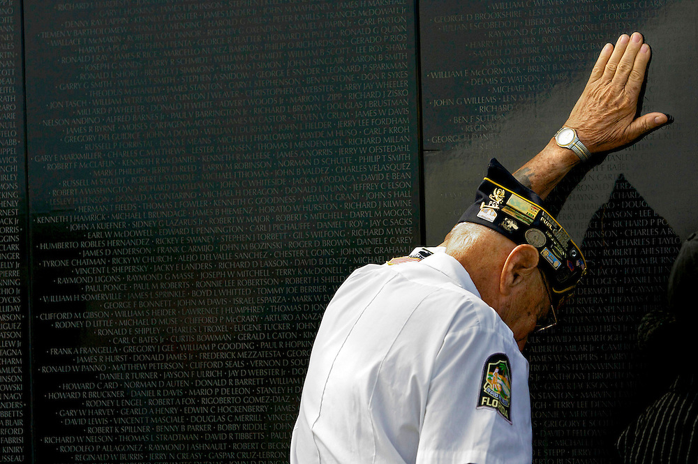 Naples resident Jules Futo takes a moment to remember his son, John Futo, who was killed the day after his 21st birthday in the Vietnam War, during an opening ceremony for the Dignity Memorial Vietnam Wall on Friday, September 26, 2008 at Naples Memorial Garden.