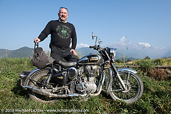 Scotty Busch poses with a spectacular background of 23,000' peaks on day-4 our our Himalayan Heroes adventure riding from Pokhara to Kalopani, Nepal. Friday, November 9, 2018. Photography ©2018 Michael Lichter.