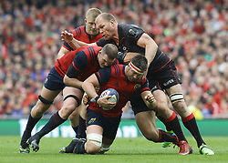 Munsters Billy Holland supported by Donnacha Ryan tackled by Saracens' Schalk Burger during the European Champions Cup, Semi Final match at the Aviva Stadium, Dublin.