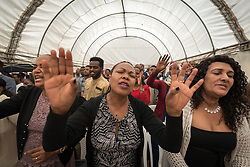 27 October 2019, Addis Ababa, Ethiopia: Congregants sing and pray during Sunday service at the Finfinne Oromo Mekane Yesus Congregation of the Ethiopian Evangelical Church Mekane Yesus. In a context where congregations did not use to be allowed to hold their services in any language but Amharic, the congregation today is one of some 60 Oromo speaking Mekane Yesus congregations in Addis Ababa. The service takes place on the first Sunday following political turmoil in the country, claiming dozens of lives.