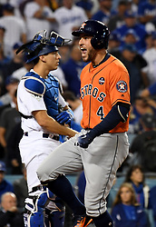 November 1, 2017 - Los Angeles, California, U.S. - Houston Astros' George Springer (4) celebrates in front of Los Angeles Dodgers catcher Austin Barnes (15) as he crosses home plate after hitting a two run home run off of Los Angeles Dodgers' Yu Darvish (not pictured) in the 2nd inning of game seven of a World Series baseball game at Dodger Stadium on Wednesday Nov. 1, 2017 in Los Angeles. (Photo by Keith Birmingham, Pasadena Star-News/SCNG) (Credit Image: © San Gabriel Valley Tribune via ZUMA Wire)