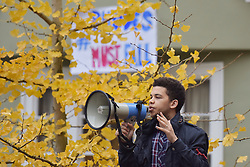 © Licensed to London News Pictures. 06/11/15 Oriel Square Oxford. UK. Protestor Sizwe Mpofu-Walsh. Protest for the removal of the statue of Cecil Rhodes which is in the front of Oriel College Oxford.. Photo credit : MARK HEMSWORTH/LNP