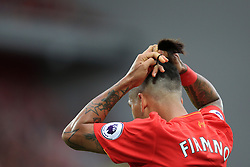 24th September 2016 - Premier League - Liverpool v Hull City - Roberto Firmino of Liverpool ties up his ponytail hairstyle - Photo: Simon Stacpoole / Offside.