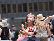 A child dancing to a DJ playing soul music at a rally in Chicago's Federal Plaza against Donald J. Trump