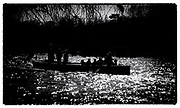 """Henley on Thames,  GREAT BRITAIN,  30th March 2003, Rowing - Henley Boat Races (Women's Varsity Boat Race), 2003 Women's Boat Race,  Cambridge, Blue Boat followed by the umpires launch,  Sport,, """"Film Noir Style Photography"""", © Peter SPURRIER,"""