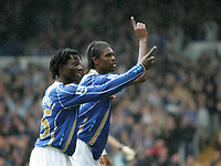 Photo: Lee Earle.<br /> Portsmouth v Bolton Wanderers. The FA Barclays Premiership. 18/08/2007.Portsmouth's Benjani(L) celebrates with Kanu after he scored their first goal.