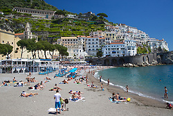 Beach, Amalfi, Italy. Sunbathers enjoy a sunny may day