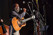 Folk and blues singer Josh White, Jr. on stage at the Folk City benefit concert at the Museum of the City of New York. The concert was held to support a forthcoming exhibit on the folk msusic revival in New York in the 1950s and 60s.