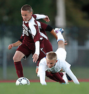 Plainville's Nick Damico goes down as Bristol Central's Zach Aldieri gets the ball during a game between Bristol Central and Plainville.