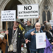 Royal Court of Justice, London, UK. 2021-10-27:  Julian Assange campaigners hold a protest outside the Royal Courts of Justice at the start of the US extradition appeal hearing.