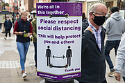 A shopper wears a face covering to help prevent the spread of the coronavirus on 26 September 2020 in Windsor, United Kingdom. The Royal Borough of Windsor and Maidenhead is aware of a rise in local coronavirus infections, has a COVID-19 outbreak management plan in place to try to ensure that the numbers do not increase further and has requested access to more coronavirus testing sites with this in mind.