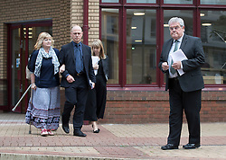 "© Licensed to London News Pictures. 03/06/2016. Woking, UK.  Doreen James (L) and Des James (R) leave Woking Coroner's Court. A second inquest into the death of army recruit Private Cheryl James has announced its verdict today. Coroner Brian Barker QC has ruled the death of Private James was caused by a ""self-inflicted"" wound. Cheryl was found dead with a bullet wound to her head in November 1995.  Aged just 18 she was one of four young soldiers who died at the Deepcut Barracks in Surrey between 1995 and 2002, amid claims of bullying and abuse. Photo credit: Peter Macdiarmid/LNP"