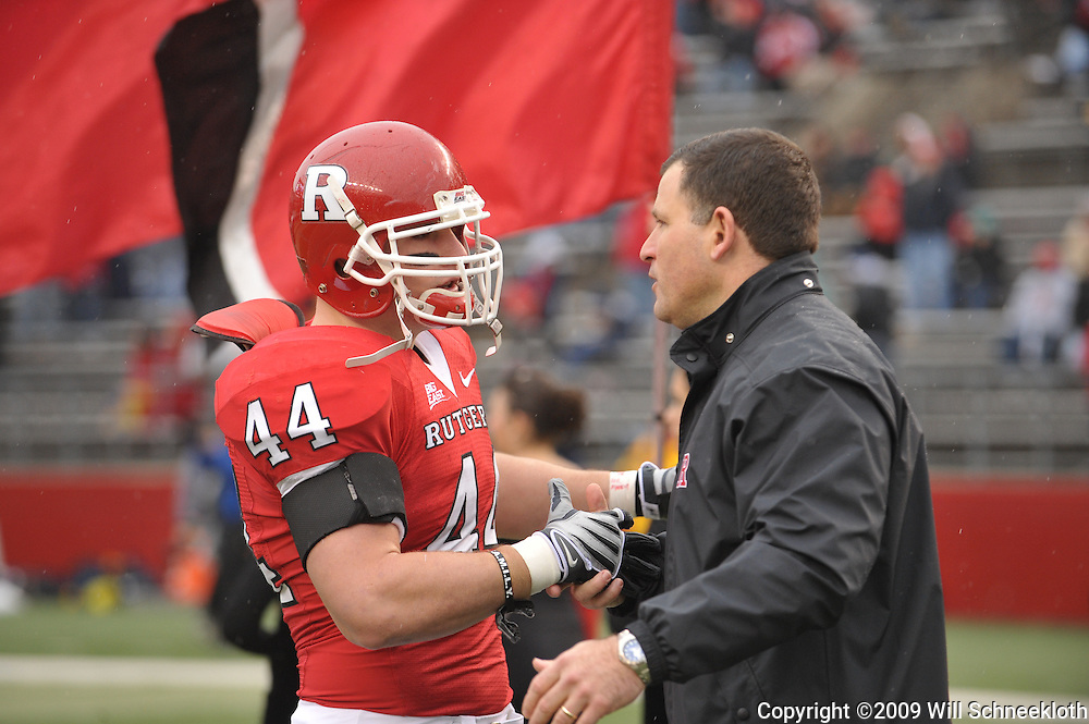 Dec 5, 2009; Piscataway, NJ, USA; Rutgers head coach Greg Schiano shakes hands with linebacker Ryan D'Imperio during the senior ceremony before first half NCAA Big East college football action between Rutgers and West Virginia at Rutgers Stadium.