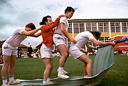 Sports day at Butlins Holiday Camp in Skegness. Butlins Skegness is a holiday camp located in Ingoldmells near Skegness in Lincolnshire. Sir William Butlin conceived of its creation based on his experiences at a Canadian summer camp in his youth and by observation of the actions of other holiday accommodation providers, both in seaside resort lodging houses and in earlier smaller holiday campsThe camp began opened in 1936, when it quickly proved to be a success with a need for expansion. The camp included dining and recreation facilities, such as dance halls and sports fields. Over the past 75 years the camp has seen continuous use and development, in the mid-1980s and again in the late 1990s being subject to substantial investment and redevelopment. In the late 1990s the site was re-branded as a holiday resort, and remains open today as one of three remaining Butlins resorts.