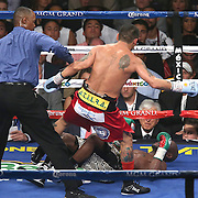 LAS VEGAS, NV - SEPTEMBER 13: (L-R) Floyd Mayweather Jr. falls after a push by Marcos Maidana during their WBC/WBA welterweight title fight at the MGM Grand Garden Arena on September 13, 2014 in Las Vegas, Nevada. (Photo by Alex Menendez/Getty Images) *** Local Caption *** Floyd Mayweather Jr; Marcos Maidana