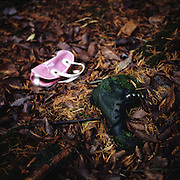 A boot and small bag lie in the undergrowth of Aokigahara Jukai, better known as the Mt. Fuji suicide forest, which is located at the base of Japan's famed mountain west of Tokyo, Japan.