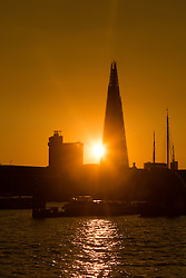 © Licensed to London News Pictures. 31/03/2016. London, UK. Warm golden sunset behind the London Shard this evening after sunny spring weather in London today. Photo credit : Vickie Flores/LNP