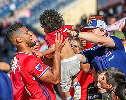 June 10, 2017 - Sat June 10th - Chicago Fire defender Johan Kappelhof (4)is handed a toddler after their victory of their MSL Soccer game between The Chicago Fire and Atlanta United at Toyota Park in Bridgeview, IL. (Credit Image: © Gary E Duncan Sr via ZUMA Wire)
