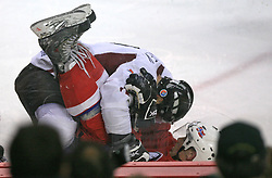 Herberts Vasiljevs (12) at the top of Norwegian player at ice-hockey match Latvia vs Norway at Qualifying round Group F of IIHF WC 2008 in Halifax, on May 11, 2008 in Metro Center, Halifax, Canada. (Photo by Vid Ponikvar / Sportal Images)