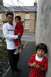 Father & children living in deprived area of Halifax; Yorkshire; UK