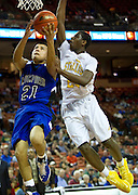 Josh Sustaita (21) of Mumford drives to the basket against Dallas Triple A Academy during the UIL 1A division 1 state championship game at the Frank Erwin Center in Austin on Friday, March 8, 2013. (Cooper Neill/The Dallas Morning News)