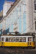 A tram passes by Loreto Church in Chiado district in Lisbon.