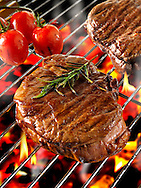 Barbecue fillet steak cooking on a BBQ grill