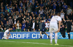 Leeds United's Liam Cooper (left) is shown a red card by referee Kevin Friend (right) during the Sky Bet Championship game at the Cardiff City Stadium.