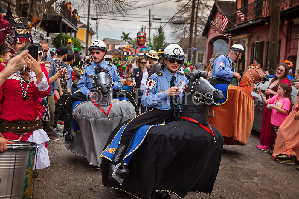Mounted Police leading the Red Beans Parade on Lundi Gras during Mardi Gras on 25th February 2020 in New Orleans, Louisiana, United States. Mardi Gras is the biggest celebration the city of New Orleans hosts every year. The magnificent, costumed, beaded and feathered party is laced with tradition and  having a good time. Celebrations are concentrated for about two weeks before and culminate on Fat Tuesday the day before Ash Wednesday and Lent.