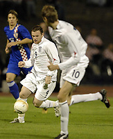 """Photo: Richard Lane.<br />Croatia v England. UEFA European Championships 2008 Qualifying. 11/10/2006. <br />England""""s Wayne Rooney plays the ball through to Peter Couch."""
