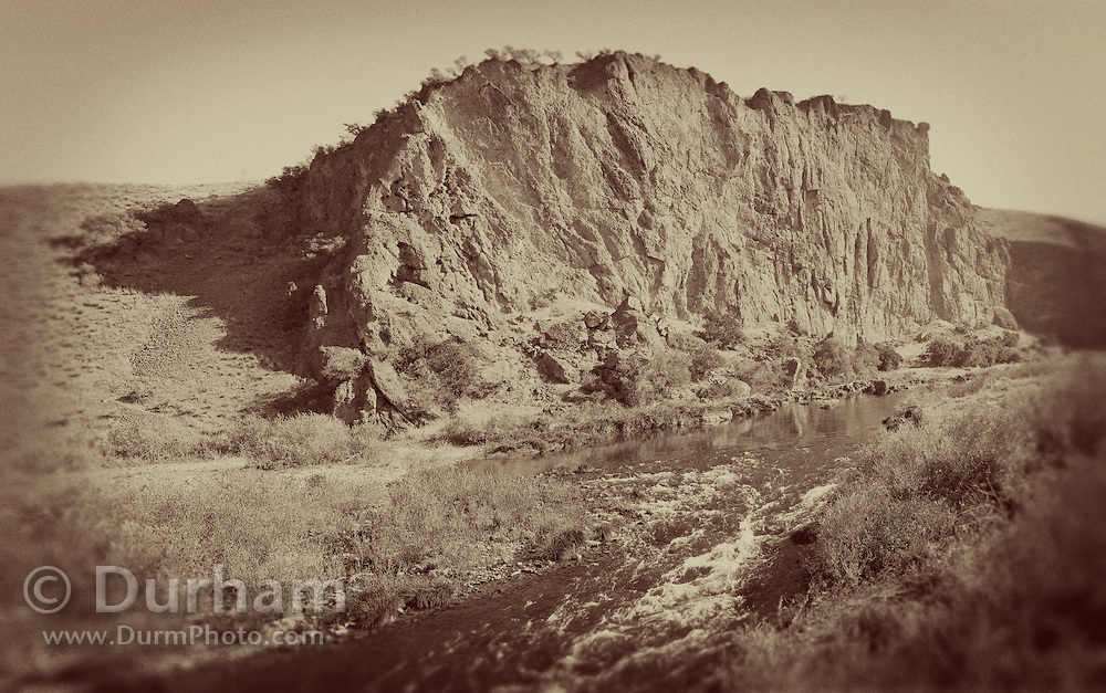 Goose Rock, a geologic formation above the John Day River in the John Day Fossil Beds National Monument, Oregon. Please note: a filter has been applied to give this image a vintage look.