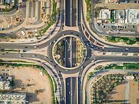 Aerial view of geometrical roundabout and roads in Al Jimi area, Abu Dhabi, UAE.
