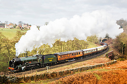 """© Licensed to London News Pictures. 18/02/2018. Goathland UK. The 1934 steam engine 926 """"Repton"""" pulls the Pullman dinning service through the village of Goathland this morning in the North Yorkshire Moors on it's way to Pickering along the North Yorkshire Moors Railway. Photo credit: Andrew McCaren/LNP"""