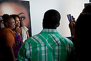 """Mara Brock Akil, creator and executive producer of  BET's """"Being Mary Jane"""", poses for photos with guests after a screening at the W Hotel in Dallas, Texas on June 22, 2013."""