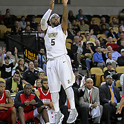 Central Florida guard Marcus Jordan (5) shoots the ball against Louisville during their game at the UCF Arena on December 15, 2010 in Orlando, Florida. UCF won the game79-58. (AP Photo/Alex Menendez)