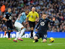 Tottenham Hotspur's Gylfi Sigurosson falls under Manchester City's Fernandinho's challenge - Photo mandatory by-line: Dougie Allward/JMP - Tel: Mobile: 07966 386802 24/11/2013 - SPORT - Football - Manchester - Etihad Stadium - Manchester City v Tottenham Hotspur - Barclays Premier League