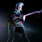 """Anne Erin """"Annie"""" Clark of the band St. Vincent performs in concert at the Amway Arena on Wednesday, December 17, 2014 in Orlando, Florida. (AP Photo/ Alex Menendez)"""