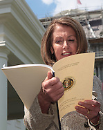 House speaker Nancy Pelosi D CA) looks at the Council of Economic Advisors Economic Impact report as the House and Senate leadership talk to media after a bipartison leadership meeting with President Obama. Photo by Dennis Brack