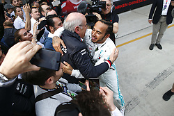 April 14, 2019 - Shanghai, China - Motorsports: FIA Formula One World Championship 2019, Grand Prix of China, ..Dr. Dieter Zetsche (GER, Chairman of the Board of Management of Daimler AG, Head of Mercedes-Benz Cars), #44 Lewis Hamilton (GBR, Mercedes AMG Petronas Motorsport) (Credit Image: © Hoch Zwei via ZUMA Wire)