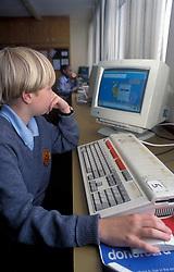 Schoolboy working at computer secondary school UK