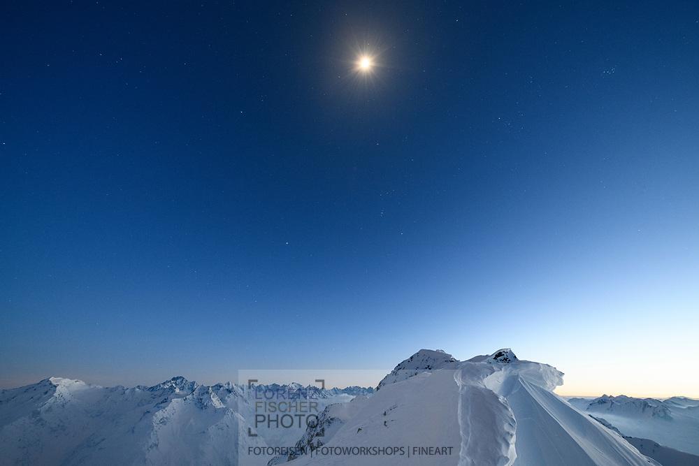 The moon is rising over the peak ridge, Parc Ela, Grisons, Switzerland