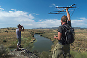Amus Wildlife Recovery Center staff tracking released birds, Rio Matachel, Llera, Extremadura, Spain.