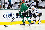 DALLAS, TX - OCTOBER 17:  Brenden Dillon #4 of the Dallas Stars controls the puck against the San Jose Sharks on October 17, 2013 at the American Airlines Center in Dallas, Texas.  (Photo by Cooper Neill/Getty Images) *** Local Caption *** Brenden Dillon